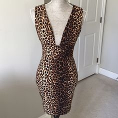 Mystic leopard print deep v neck dress Gorgeous leopard print dress by Mystic features deep v neckline and back zipper closure. 96% polyester 4% spandex. Bust of dress is lined. Fabric stretches for form fitting/flattering fit. Measurements: Bust: 28 in.  Waist:25 in.  Hips:32 in.  Length:34 in. Mystic Dresses