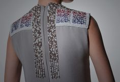 """Wearable Art, Thorunn Arnadottir, Designer, QR U? (detail), beaded dress, patterns on this beaded dress are QR codes, """"allows her to use the promotional ability of the internet to the maximum, while appearing in public offline"""" Photography Eugenia Walberg"""