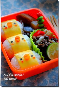chick onigiri bento (with rice and omelette, carrot lips, ketchup cheeks and paper-punched seaweed eyes)