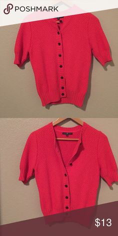 """Gap short sleeved button down sweater. Short sleeve cardigan perfect for fall. Deep orange coral/crimson. Pairs wonderfully with jeans, skirts, dresses, etc. Skirt sold separately or make me an offer for both 🤗 Sweater measures 17"""" across and 21"""" in length. Shoes NFS.  Environment is smoke and pet free. GAP Sweaters Cardigans"""