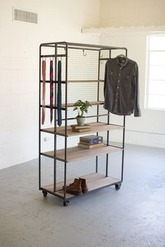 DETAILS This effecient rolling storage rack is a single solution with for your home. With 6 wooden shelves, 10 movable hooks & sides for hanging scarves, belts and hats. Product: Shelf Construction Ma