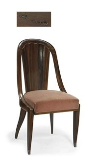 EMILE-JACQUES RUHLMANN (1879-1933).  'PALETTE' CHAIR, CIRCA 1925 In Macassar ebony, with carved back, on sword-shaped front legs and curved and sloping back legs, The model was exhibited at the Pavillon du Collectionneur, in the dining room designed by Emile-Jacques Ruhlmann, within the French section of the Exposition Internationale des Arts Décoratifs et Industriels Modernes, Paris, 1925.