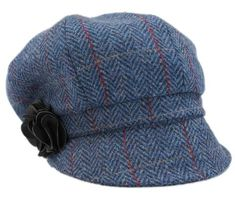 "Get a contemporary Irish style with this women's newsboy cap! This cap features a short brim with a fabric flower for that feminine touch! Find it in a variety of colors and patterns! It has an elastic band for a perfectly comfortable snug fit! This Irish cap is crafted from a 100% wool tweed shell with polyester lining for guaranteed warmth. It measures approximately 23"" but can expand to 27"" when fully extended."