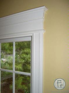 Trim around window ~ Perfect for window behind tv since i don't want to put curtains there. window casing ideas.