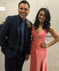 Miss America 2014 Nina Davuluri with boxing legend Oscar De La Hoya who is being inducted into the International Boxing Hall of Fame this weekend. Dress by Tony Bowls.