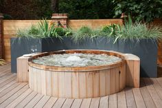 Wrap-around garden design in Allison Grove, Dulwich, 7 Hot Tub Backyard, Hot Tub Garden, Small Garden Hot Tub Ideas, Garden Ideas, Garden Features, Water Features, Hot Tub Surround, Tub Enclosures, Back Garden Design
