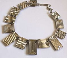 very rare YVES SAINT LAURENT silver numbered necklace with poured glass | From a unique collection of vintage link necklaces at https://www.1stdibs.com/jewelry/necklaces/link-necklaces/