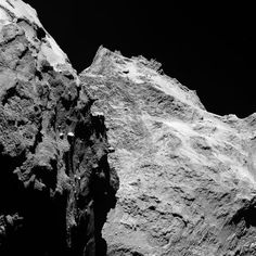 Rosetta's Comet on 5 September 2014: Jagged cliffs and prominent boulders are visible in this image taken by OSIRIS, Rosetta's scientific imaging system, on 5 September 2014 from a distance of 62 kilometres from comet 67P/Churyumov-Gerasimenko. The left part of the image shows a side view of the comet's 'body', while the right is the back of its 'head'.
