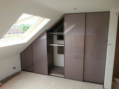 Bespoke Fitted Sloping Ceiling wardrobe with Modern Minimalist Sliding Doors, Manufactured and fitted by Kleiderhaus. For more info please visit www.kleiderhaus.co.uk or call us on 0207 0961860. #fittedwardrobes #fittedbedrooms #fittedbedrooms #bespokefurniture #bespokewardrobes #bespokebedrooms #bespokeslidingdoors #slidingwardrobedoors #slopinceilingfurniture #awkwardspacefurniture #kleiderhaus