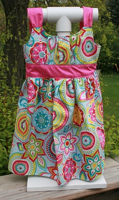 Turquoise floral dress - front by be the thread, via Flickr  Also check out the cool homemade dress holder!