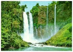 """The Maria Cristina Falls  The famous """"twin"""" waterfalls comes from the legend of two sisters, Maria and Cristina. The direct falls is a no swimming zone because of its 80 meters height. But native children do not mind the torrential waterfall and its water spray and jump from high rocks to the water."""