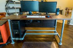 building desk from pipe | Wood Paneled Industrial Pipe Desk [Desk Week]