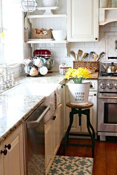 White kitchen with farmhouse sink and spring decor - www.goldenboysandme.com