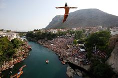 Competitors dive from the Old Mostar Bridge  in Mostar, south of Bosnian capital of Sarajevo, Saturday. Fourteen of the world's best competitors took part in the competition diving from a 89 foot high bridge over the river of Neretva (photo by Amel Emric/AP - CSMonitor.com)