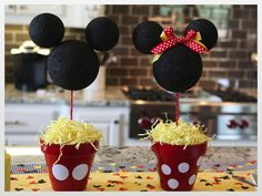 Minnie ears centerpieces from styrofoam spheres. (I'm sure there's a green alternative to styrofoam.) Via Just a Little Party