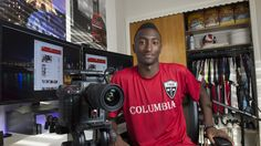Marques Brownlee, 20-year-old YouTuber is tech reviewing star, at his Hoboken, N.J., apartment.(Photo: Eileen Blass, USA TODAY)  Brownlee works with a camera in his bedroom but is one of the most influential tech reviewers.