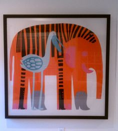 Merrimekko fabric, stretched on canvas, framed.  Great idea for art for a kids room or playroom.