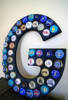 Beer bottle cap initial. I would make this with our favorite beer caps to hang in the bar area. Too fun!