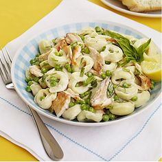 Tortellini Salad with Salmon and Peas  Cost per serving: $ 1.88  To give this salad a tasty kick, stir in a few tablespoons of freshly grated Parmesan just before serving.
