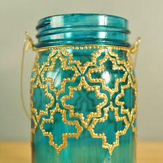 Mason Jar Lantern, Hand Painted Moroccan Design on Teal Glass with Gold Detailing via Etsy