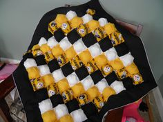 Beautiful little NFL Pittsburgh Steeler puffy quilt for baby / toddler. This quilt with three layers, on the top layer is beautiful Pittsburgh Steeler fabric print. The back is nice super soft white flannel. In the middle stuffed cotton. The quilt approximate size is 40 x 40. I also taking custom order any color pattern you like. Just contact me.