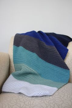 Crochet version of Purlbee's knit colorblock blanket. So much faster!!! And I love the colors.