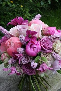 Mixed boquet with peonies & roses in hues of pink.