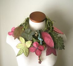 This beautiful fiber art scarf was made using a variety of techniques- hand knitting, crochet, machine & hand embroidery, and felting. Made with a ultra soft wool, silk, and cashmere blend yarn. A three season scarf- wear for Spring, Autumn, and Winter. Add some leafy goodness to