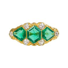 Victorian Emerald Diamond Gold Ring. An antique three-stone emerald ring with diamond accents, in 18k gold. Circa 1890