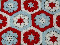Red, white and aqua. Always a great combination. Hexagon pattern here http://www.jpfun.com/patterns/free/coasters/f108032scrapsavershexagon.shtml