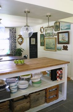 industrial kitchen island with open shelving, open to dining room, nautical gallery wall, federal mirror, glass globe pendant lights