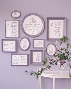 I like this idea.  Display calligraphed names, grouped according to table, in frames that form a blueprint of the reception.