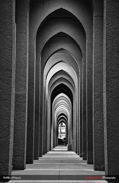 Photographer, Raed Yahya Al-Banna, uses rhythm in this photo by capturing the repetition within this architecture. We also see symmetry in this photo. Shape Photography, Pattern Photography, Street Photography, Unity Photography, Creative Photography, Photography Ideas, Photo D'architecture, Foto Picture, Elements And Principles
