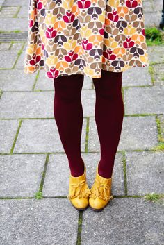 Cute print, colored tights and fun shoes!