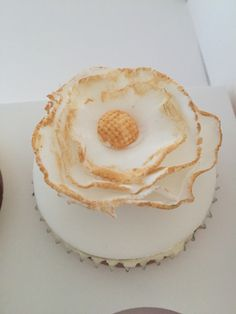 Blue and Gold Wedding: cupcake topped with a white flower edged with gold