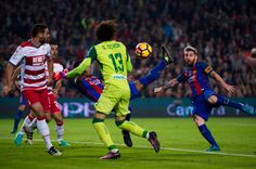 Rafinha (C) of FC Barcelona scores the opening goal with an overhead kick during the La Liga match between FC Barcelona and Granada CF at Camp Nou stadium on October 29, 2016 in Barcelona, Catalonia.