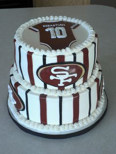 49ers Baby Shower cake.....I love the onesie, would change the cake a bit though