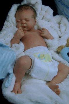 Precious! Looks like baby RJ:)