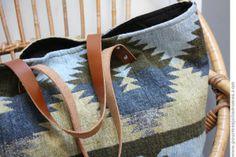 Upcycle a second hand jacket into a tote using some leather and rivets. Lovely!