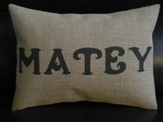 Pirate word Matey printed on natural colored fine weaved burlap. (Not a transfer) This burlap is similar to a textured linen. Envelope style back with black and cream striped print cotton or matching burlap. Slip cover is double stitched and interfaced for durability. Pillow measures slightly smaller than the 12 in. by 16 in. form to allow for fullness. Pillow form is included in this listing. Thank you for shopping Polkadot Apple Pillows