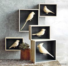 Roost Carved Wood Bird Clips are hand-carved from basswood and fitted with brass clips instead of feet. Each bird comes perched in an individual gift box, suitable for display.