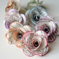 Paper flowers made from scrapbooking paper! These are super pretty- I love the text paper, and how they dusted the edges with the ink that they chose!