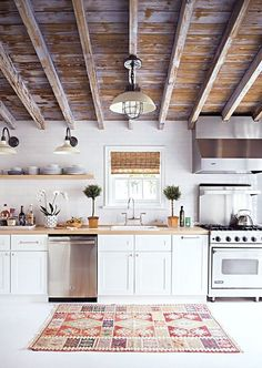 white rustic kitchen with vintage rug