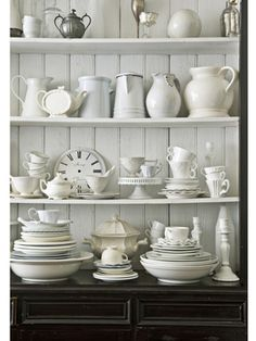 Shelves dedicated to white ceramics and china. I love the all white and cream palette with the tongue and groove backing for detail.