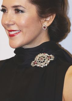 "gabriellademonaco: "" Crown Princess Mary using the parts of the brooch and earrings from the Danish Ruby Parure """