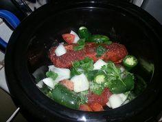Boneless pork shoulder in crock pot for tacos