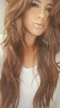 Beautiful brunette color with caramel highlights.