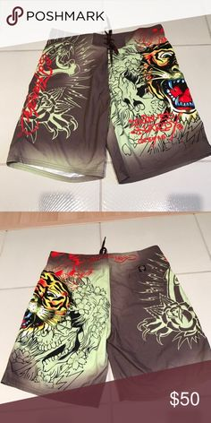 NWOT Men's Ed Hardy Tiger Board Shorts Swim 38 New without tags. Classic Ed Hardy signatures and tiger designs. Has pockets. No comb.  🚫No trades ✅ Reasonable offers considered  🚭 Smoke free home Ed Hardy Swim Board Shorts