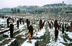 Sarajevo 1997. This cemetery was once a field where people played. At the start of war in the former Yugoslavia in 1992, the Serbian government attacked Sarajevo, the Bosnian Capital. The 43-month siege and artillery bombardment killed civilians, separated families and made daily life a matter of survival.