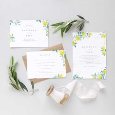 Amalfi wedding invitation design with citrus fruits and leafy greens